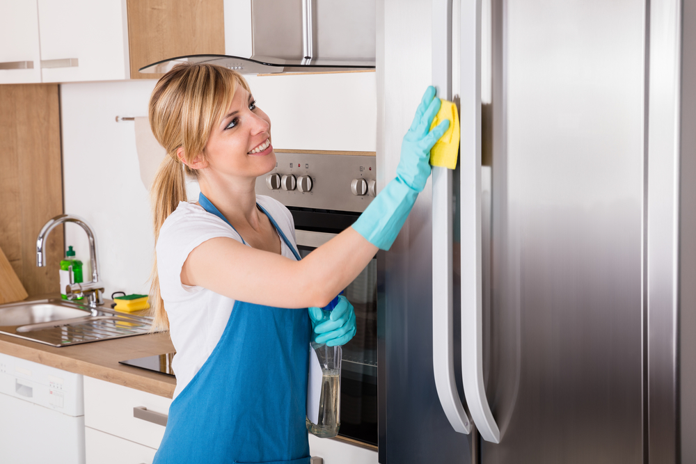 how to move a refrigerator to clean behind