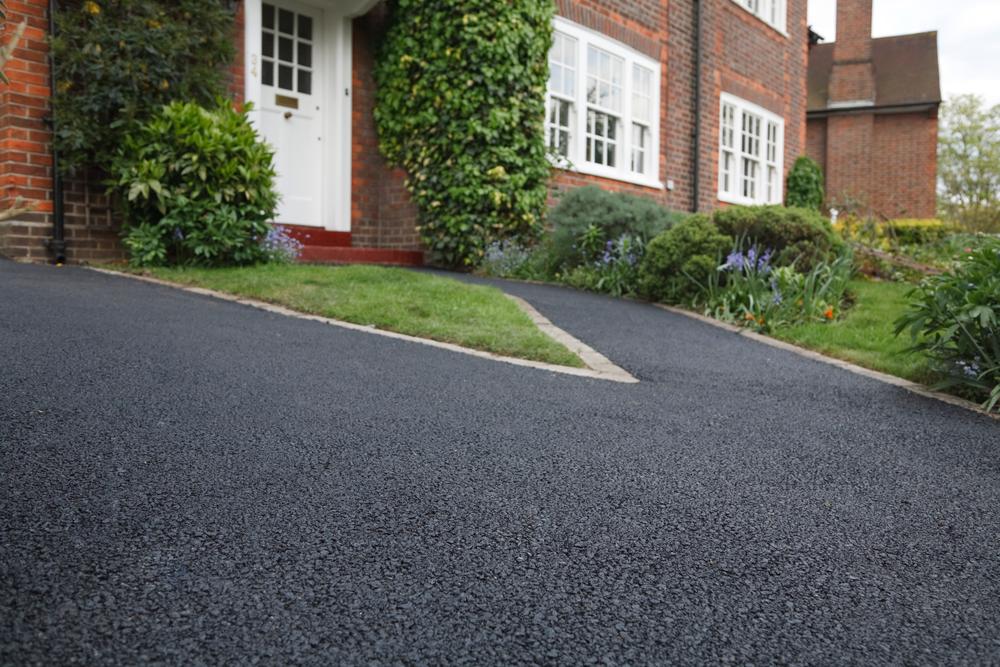 Driveway paving why asphalt always beats gravel gmg for Can i paint asphalt driveway