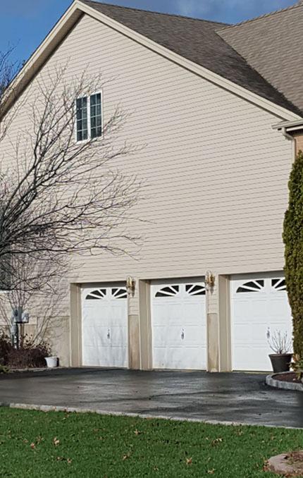 Should You Repair Or Replace Your Garage Door Serving Brooklyn