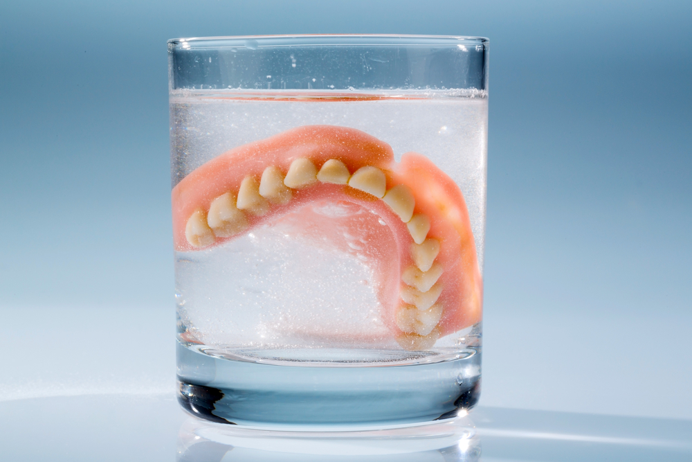 how to keep dentures in