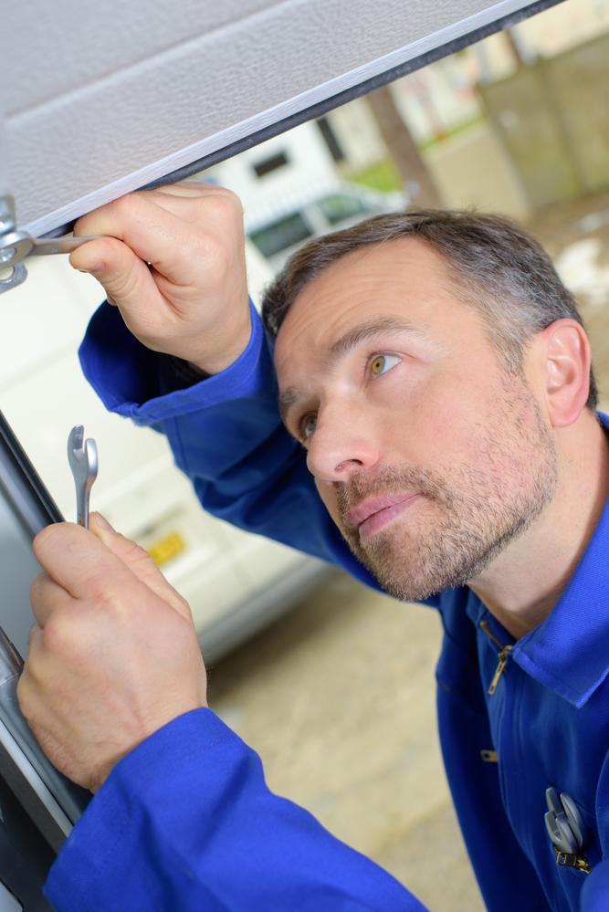 3 signs your garage door springs are broken garage door for Garage door repair rochester mn