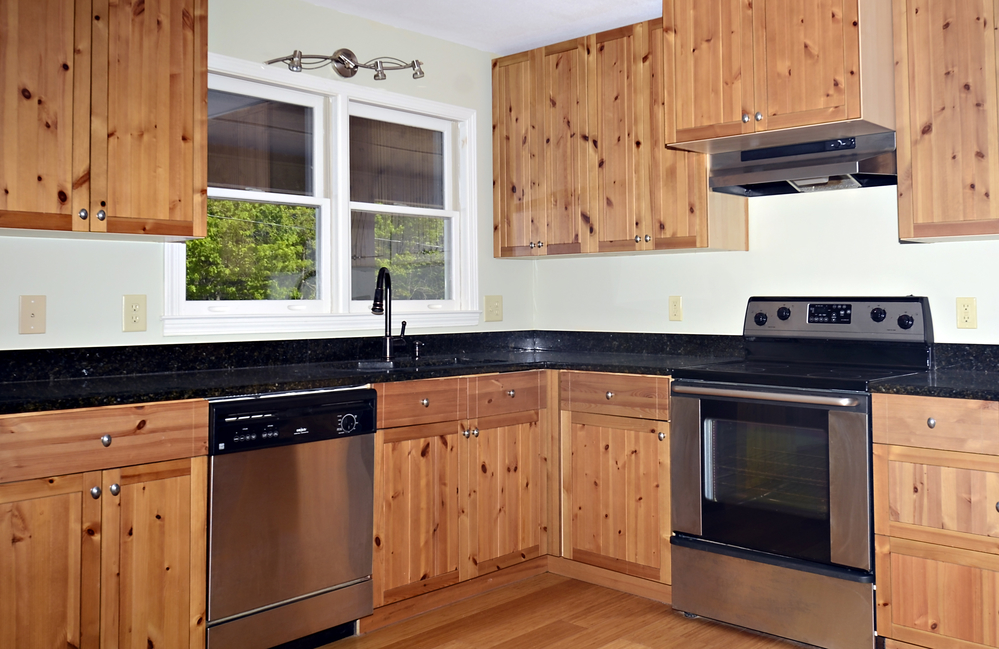 4 steps to hanging kitchen cabinets leon supply for Cincinnati kitchen cabinets