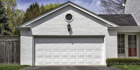 3 maintenance tasks to perform between garage door service for Concord garage door