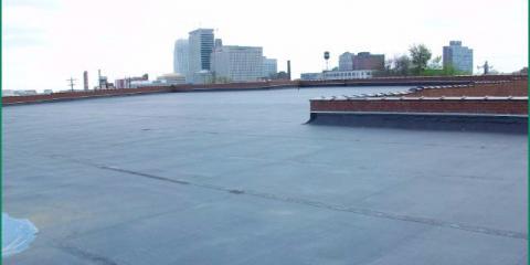 How Do Flat Commercial Roofs Drain Rainwater?, Winston, North Carolina