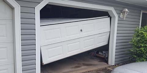 3 Steps to Take After Backing Into Your Garage Door, Blaine, Minnesota