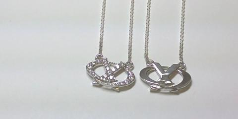 Get The New 'A Kiss Wrapped in a Hug' Necklace - The Finest in Ladies' Jewelry From Crown Fine Jewelry, Scottsdale, Arizona