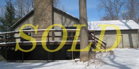 Laurie Hofer helps buyers purchase Wi. Rapids home, Nekoosa, Wisconsin